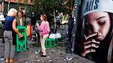 Residents of Copenhagen's Christiania demolish cannabis huts after shooting
