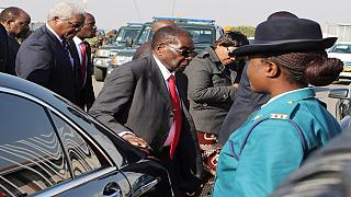 Mugabe dismisses health rumours after trip abroad raises speculation
