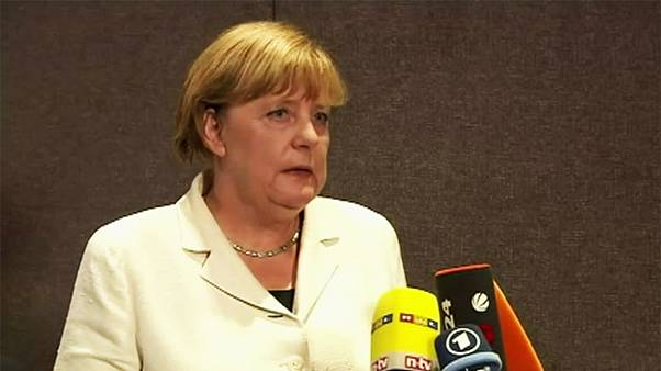 Merkel resists pressure to change refugee policy