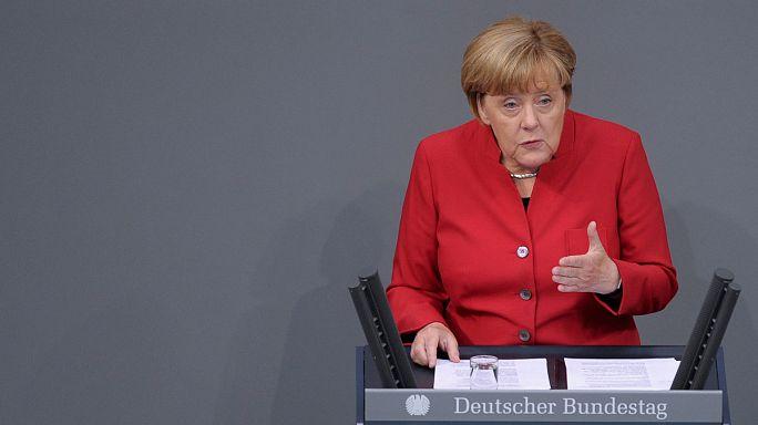 Merkel defends migrant policy despite regional election defeat