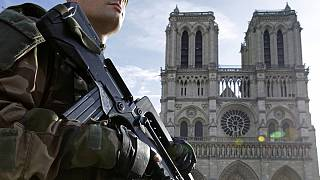 French police detain two after gas canisters found in Paris car