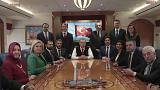 Image: Turkish President Recep Tayyip Erdogan poses for photos with Turkish