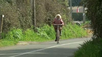 The egg seller and her bike who have a combined age of 140
