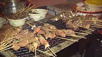 Ivorians enjoying grilled food during festival