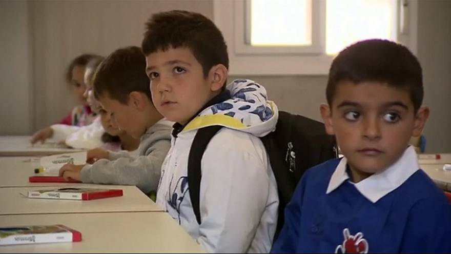 Children of quake-hit Italian town go back to school - in prefabs