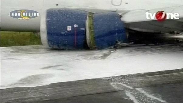 Landing without wheels: cargo plane skids down Indonesian runway