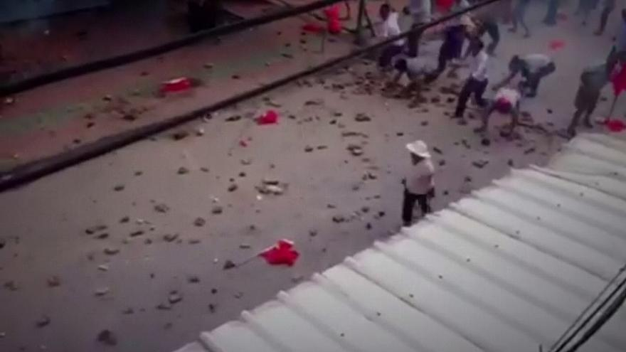 "Locals pelt riot police in China ""democracy"" village"