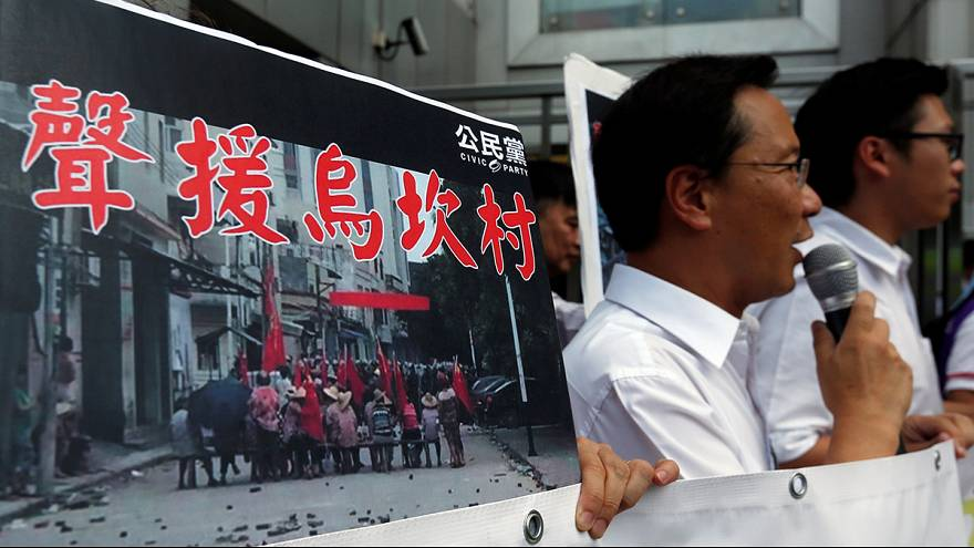 Pro-democracy activists in Hong Kong protest against Wukan clashes