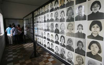 Photographs of Khmer Rouge victims on display at Tuol Sleng Genocide Museum in Phnom Penh, Cambodia.