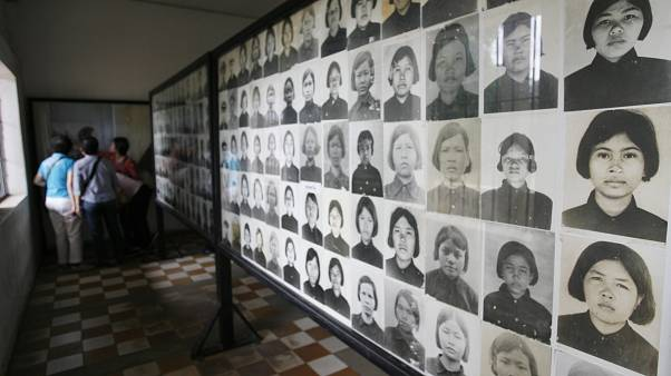 Image: Photos of Khmer Rouge victims at the Tuol Sleng Genocide Museum in 2