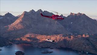 Greenland : A Formula E car speeds across an ice cap in the Arctic Circle