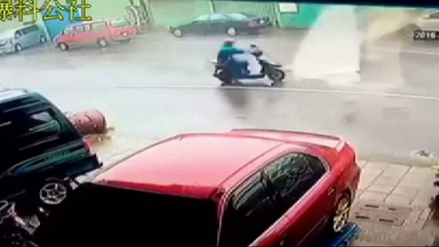 Taiwan: Motorbike rider blown away by typhoon