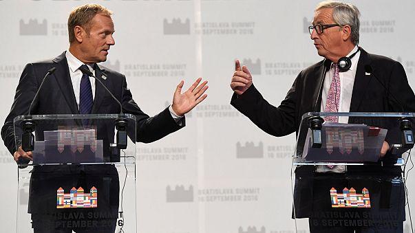 EU tries to portray unity amid splits on migration