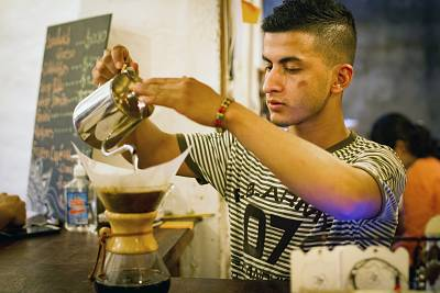 Jorge Suarez, making a coffee at his small business, the Ik-ro Cafe Bar in La Celia, Risaralda, Colombia.