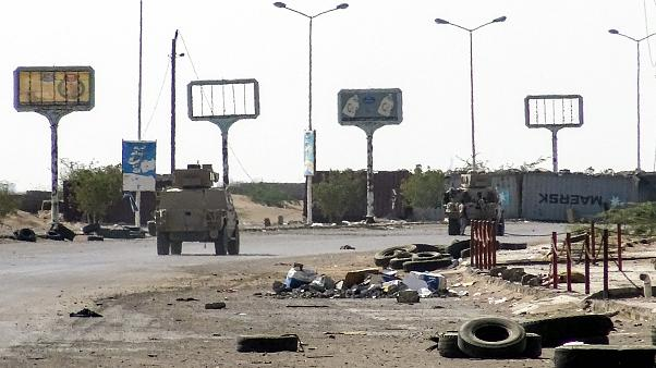 Image: Armoured vehicles of the Yemeni pro-government forces are seen drivi