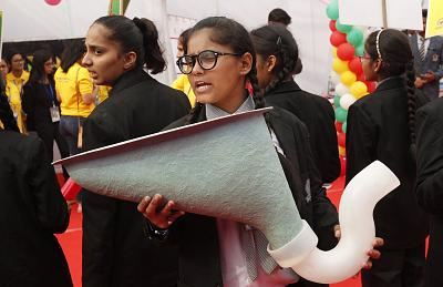 An Indian child holds a replica of an Indian-style toilet at an event held to mark World Toilet Day in New Delhi on Nov. 19, 2018.