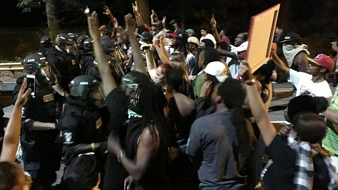 Protests in North Carolina after African American man shot by police
