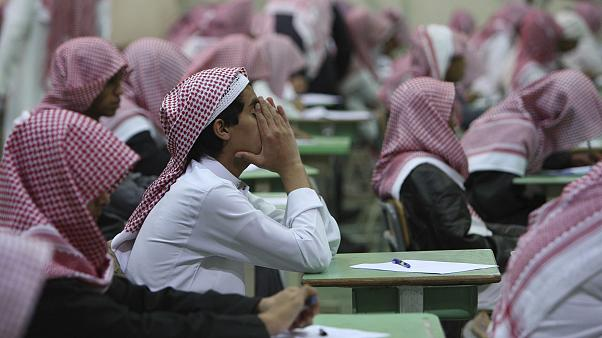 Image: Secondary school students sit for an exam in a government school in