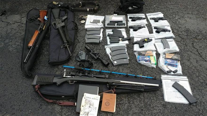 Authorities found several weapons and magazines of ammunition when they arr