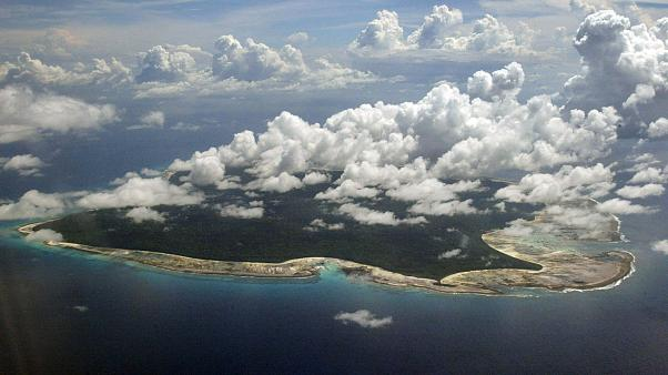 Image: Clouds hang over the North Sentinel Island, in India's southeastern
