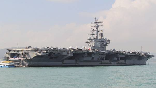 Image: U.S. Navy aircraft carrier USS Ronald Reagan during its visit to Hon