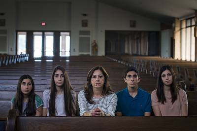 """Nahrain Hamama and her four children in their church near Detroit, Michigan. Nehrain\'s husband Usama """"Sam"""" Hamama was detained by ICE along with approximately 100 other Chaldean Christians from Michigan in June 2017. Sam, who came to the U.S. as a child, was being deported for a decades-old criminal conviction. His family worried he could be persecuted for his faith if returned to Iraq."""