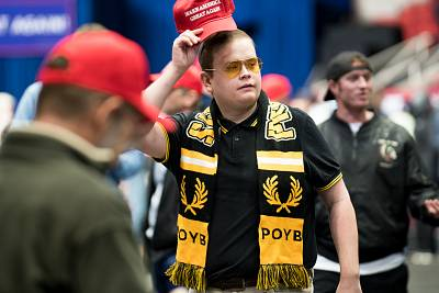 A man wearing a Proud Boys scarf walks across the venue floor before a campaign rally with President Donald Trump at the Bojangles Coliseum in Charlotte, North Carolina on October 26, 2018.