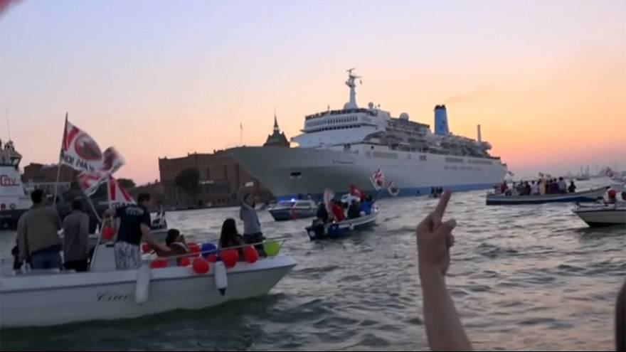 Venice canal comes to life amid noisy protest against large cruise ships