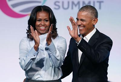 Michelle Obama appears with former President Barack Obama at the Obama Foundation Summit in Chicago.