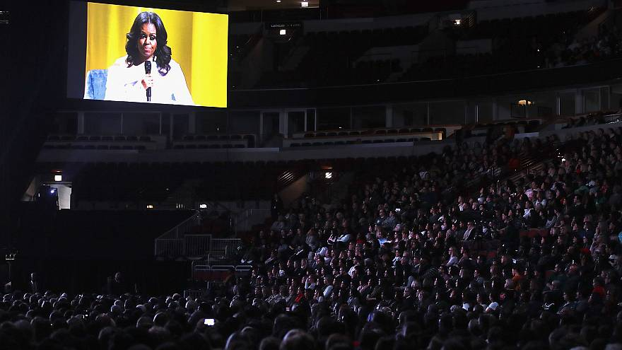 Image: Guests watch as Oprah Winfrey interviews former first lady Michelle
