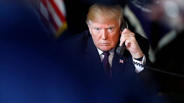 Image: U.S. President Donald Trump speaks via video teleconference with tro