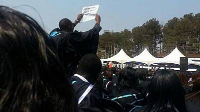 University students arrested after criticizing Mugabe in his face
