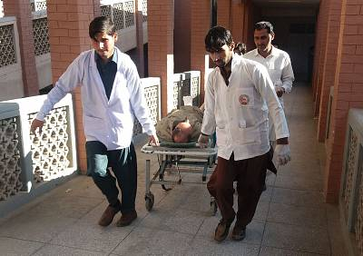Paramedics transport a victim after Friday\'s suicide bombing.