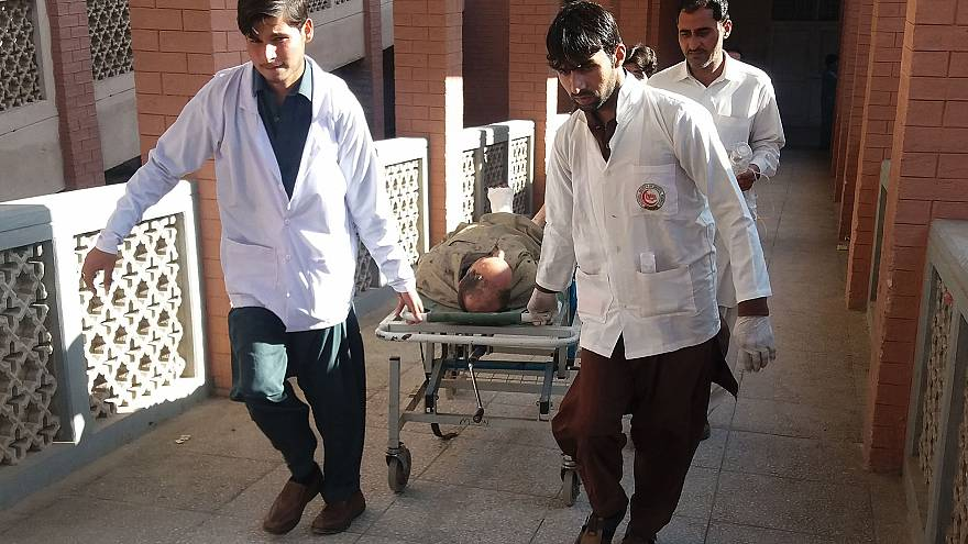 Image: Paramedics transport a victim after Friday's suicide bombing