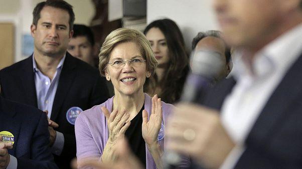 Image: Democrat U.S. Sen. Elizabeth Warren, center, applauds as Massachuset