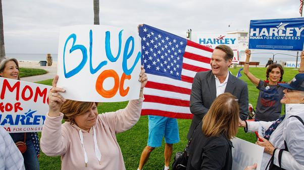 Democrat Harley Rouda greets supporters at a rally in Laguna Beach, Califor