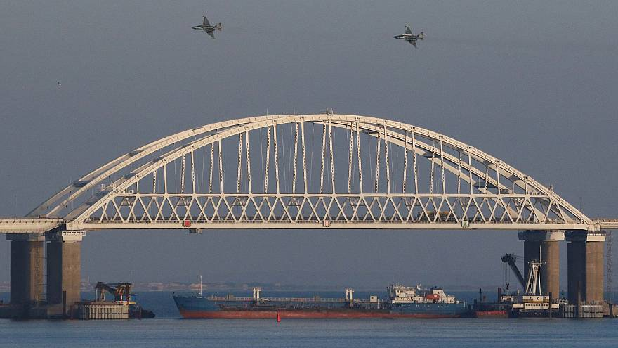 Image: Russian jet fighters fly over a bridge connecting the Russian mainla
