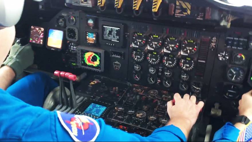 Video: Inside cabin of plane flying through the eye of Hurricane Matthew