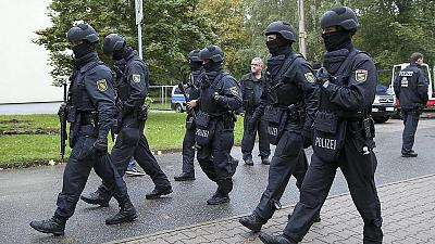 German police hunt for Syrian after explosives found in his flat