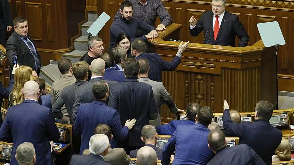 Ukrainian President Petro Poroshenko speaks during a parliament session to