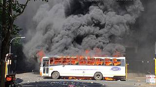 Priest shot, bus burned in violent South African student protests