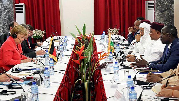 Merkel in Africa - stemming the migrant flow