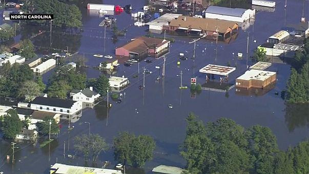Thousands evacuated from flooded Carolinas