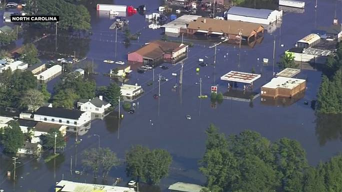 Thousands evacuated from flooded Carolinas