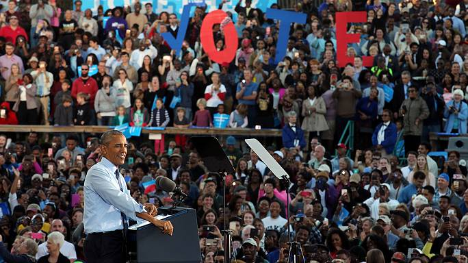 'Reject the dark side' urges Obama at a Clinton campaign rally