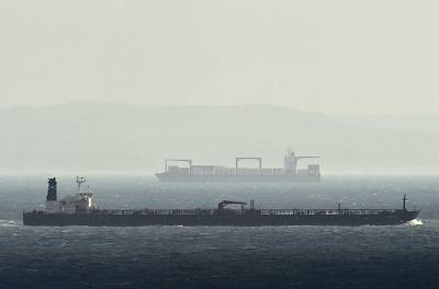 Cargo ships travel in the English Channel.