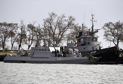 Two Ukrainian warships and a Ukrainian tugboat sit in a port in the Crimean city of Kerch after they were captured by the Russian Border Guard Service and escorted there on Monday.