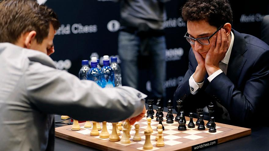 Fabiano Caruana, right, plays against Magnus Carlsen in the 2018 World Ches