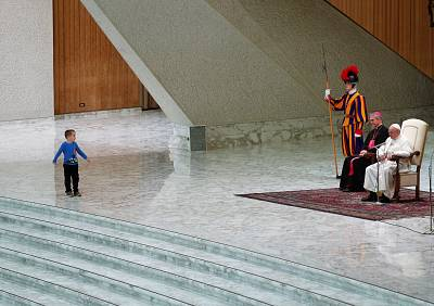 A child on stage during a general audience led by Pope Francis at the Vatican on Nov. 28, 2018.