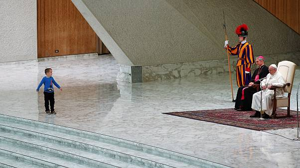 A child on stage during a general audience led by Pope Francis at the Vatic